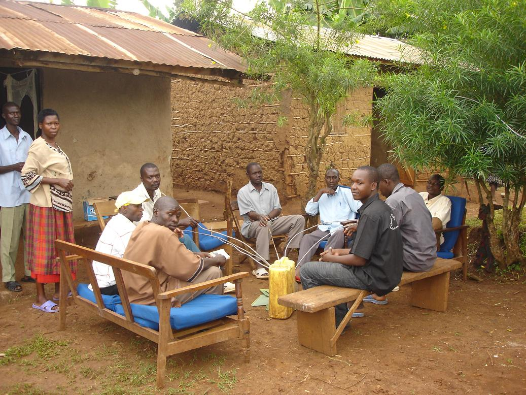 A family in Mbale partakes of malwa in their home compound in Sironko