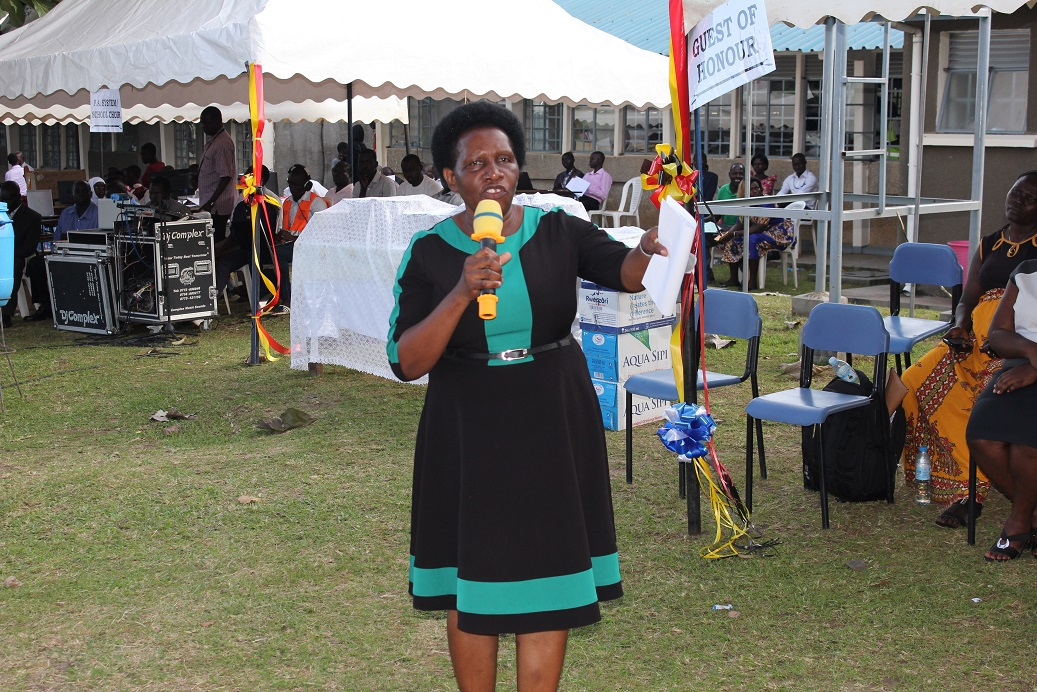 Mary Nteete the Principal Education Officer at the Education and Sports Ministry making a speech at the event
