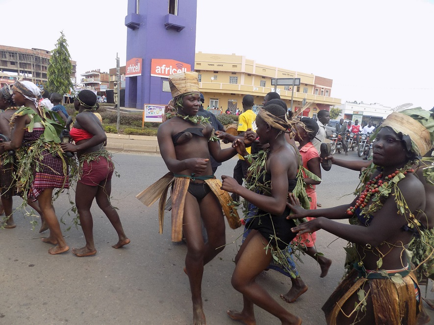 Some of the Parade participants from the Hugu enjoy a moment as the parade moves through Mbale town