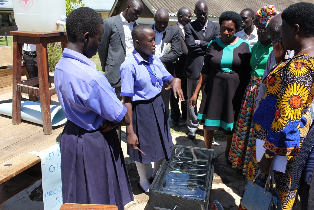 Students from St Marys Ediofe Girls S.S explaining to adjudicators how a solar Heater they built works