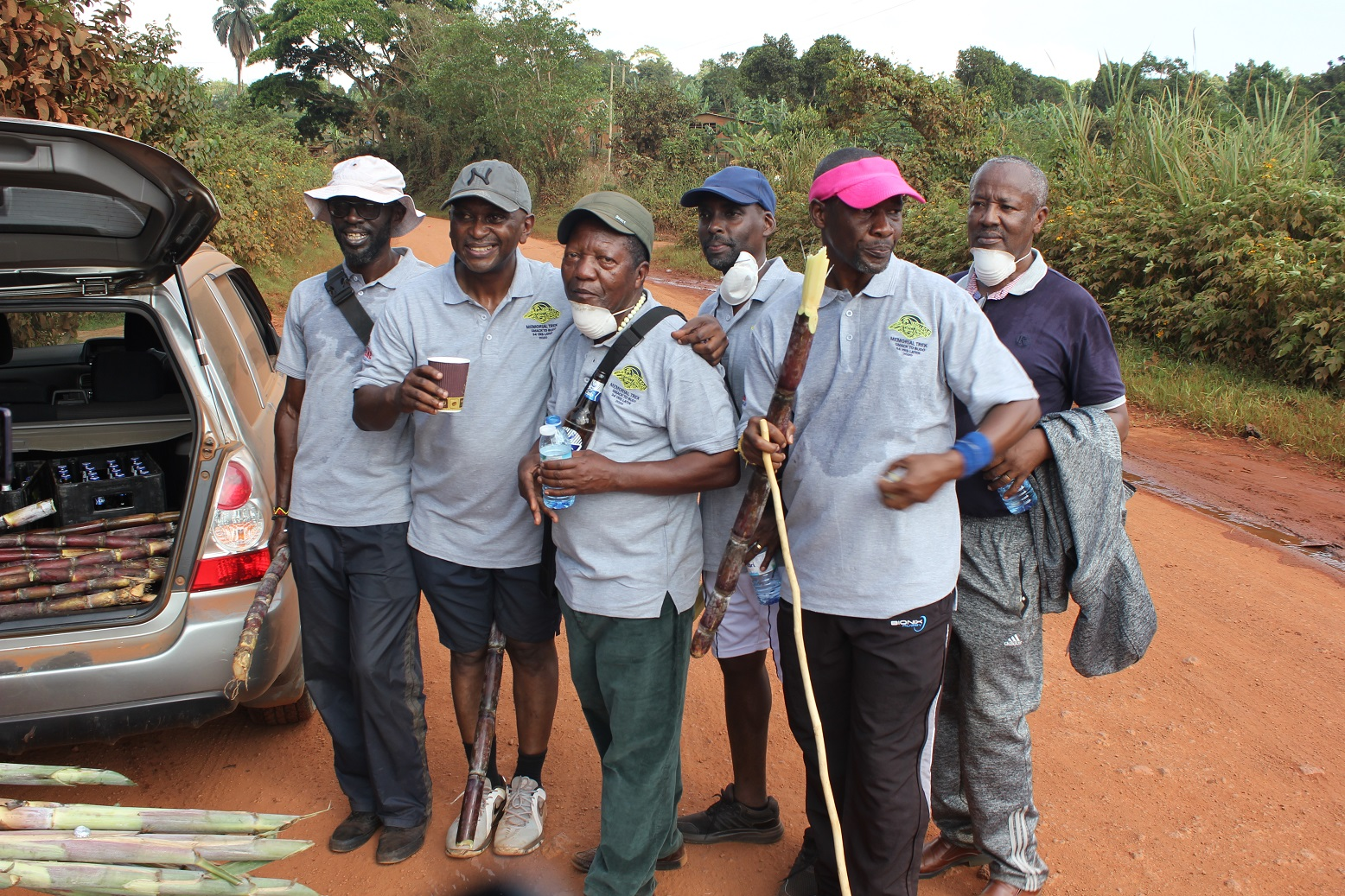 Some of the trekkers stop for a sugarcane break in Namugoga